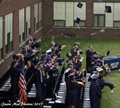 Picture of the Graduating Class tossing their caps in the air after the Graduation Ceremony.