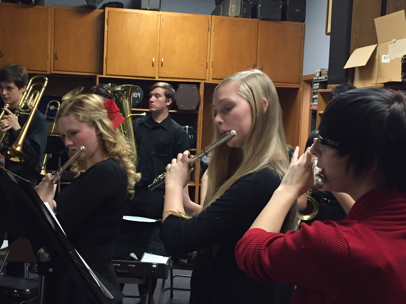 Three Flute Players