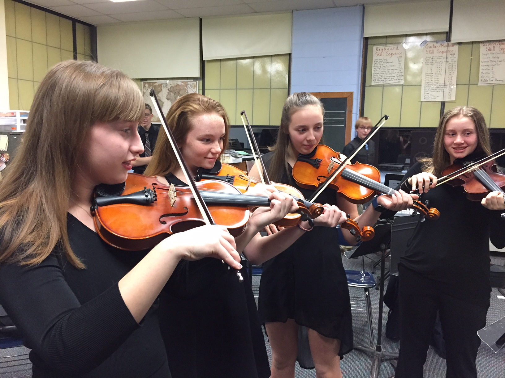 Four Violin Students