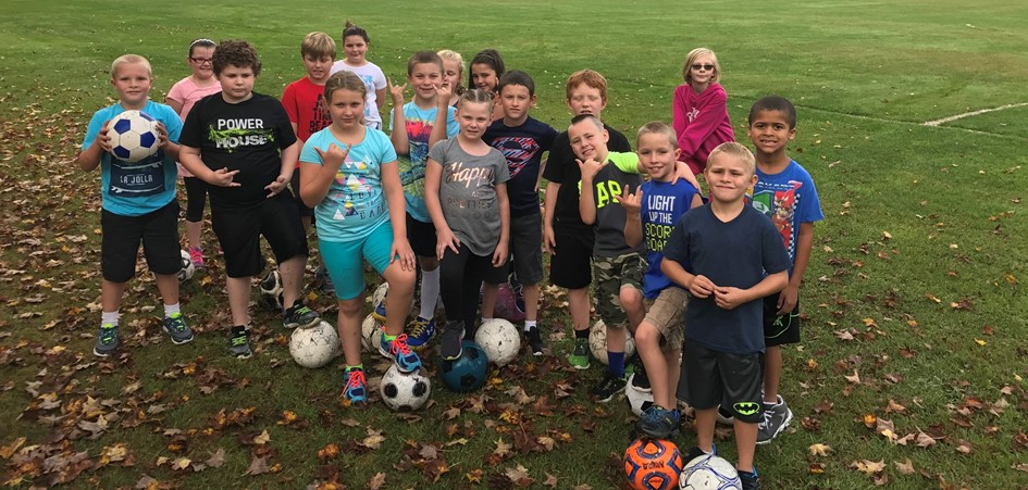Elementary students with soccer balls