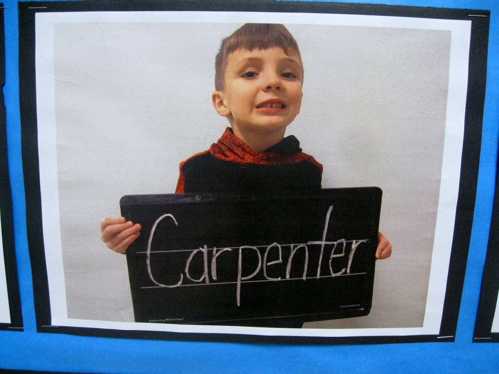 Child holding sign to show what they want to be when they grow up.