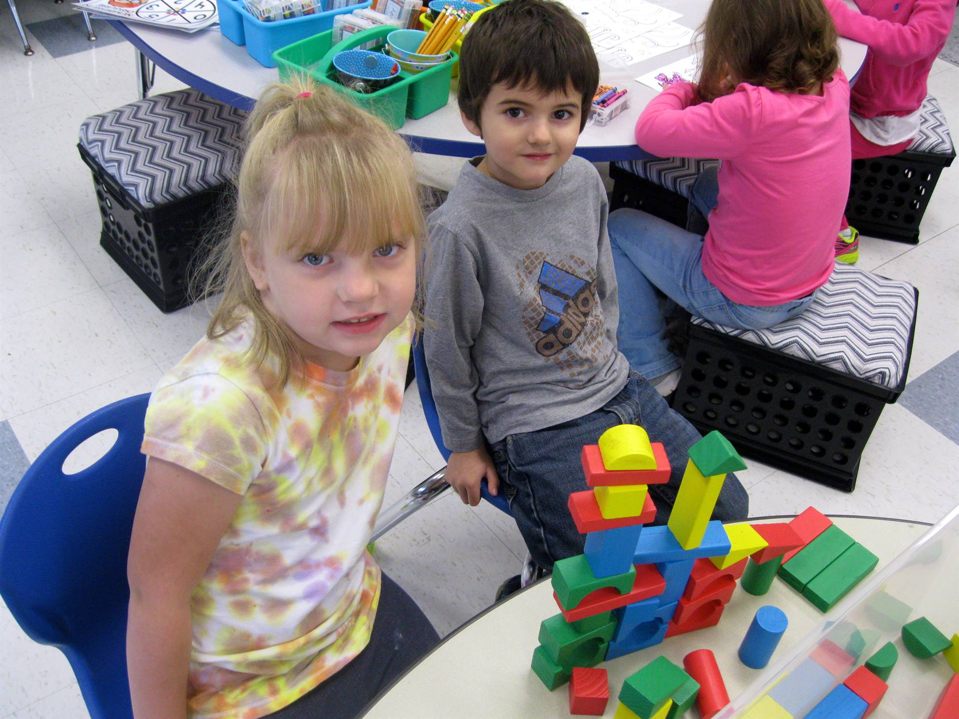2 students show off their building.