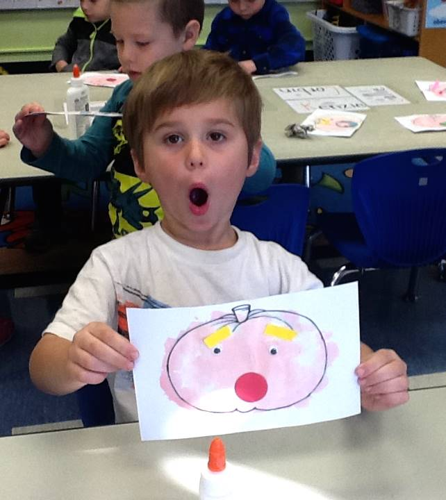 A student matches his emotion with his pumpkin's emotion.