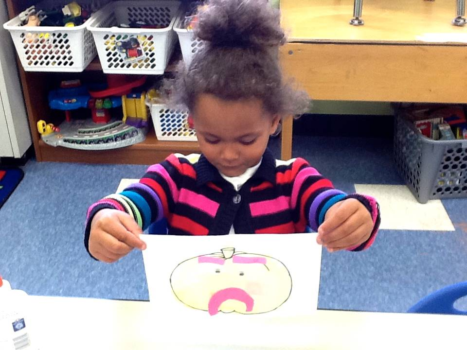 A student matches her emotion with her pumpkin's emotion.