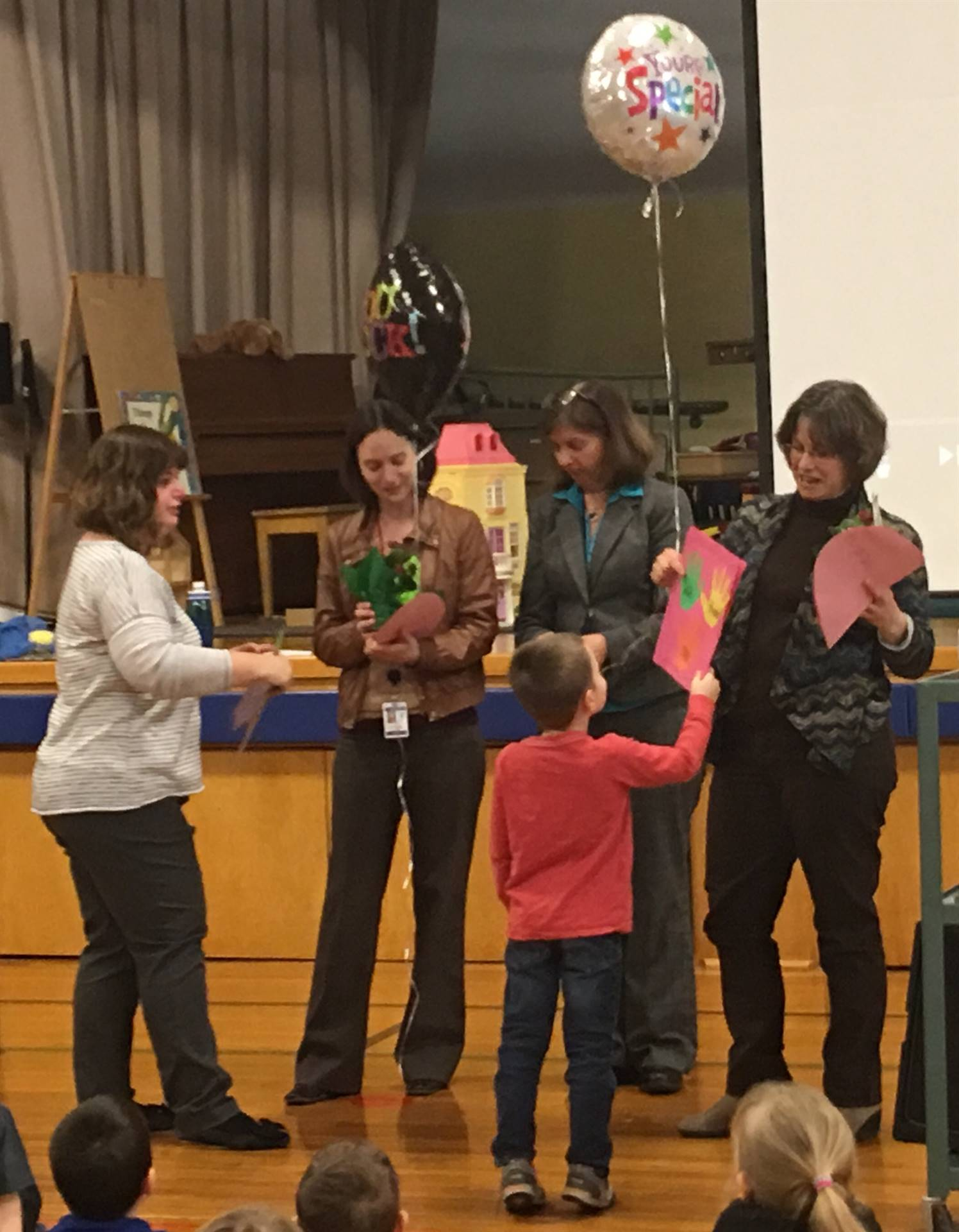 students and staff present cards and gifts to thank the Counselor team!