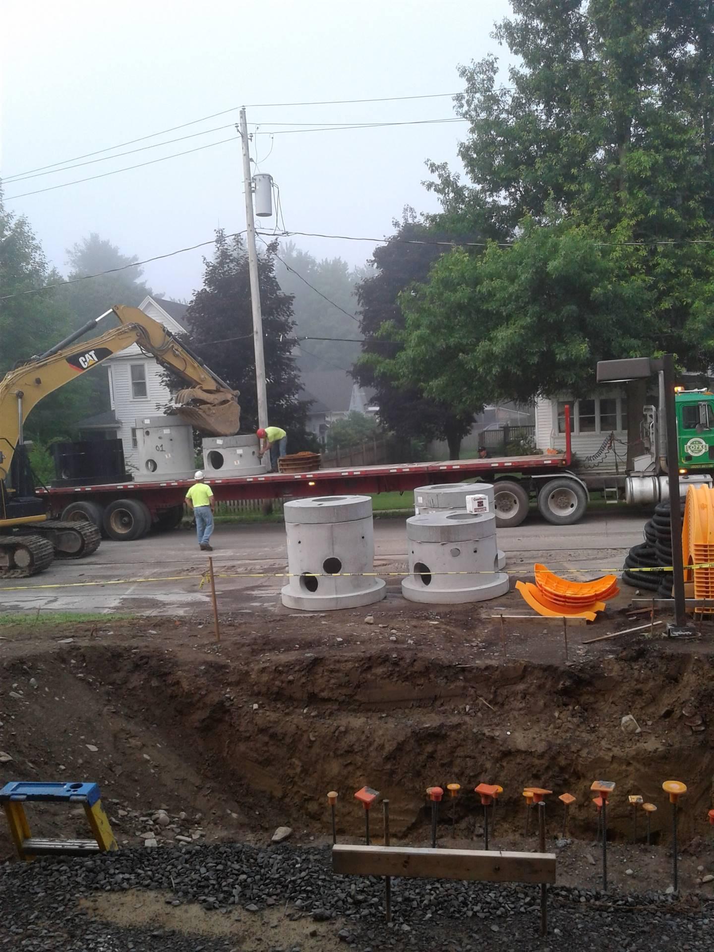Excavator unloading the catch basins
