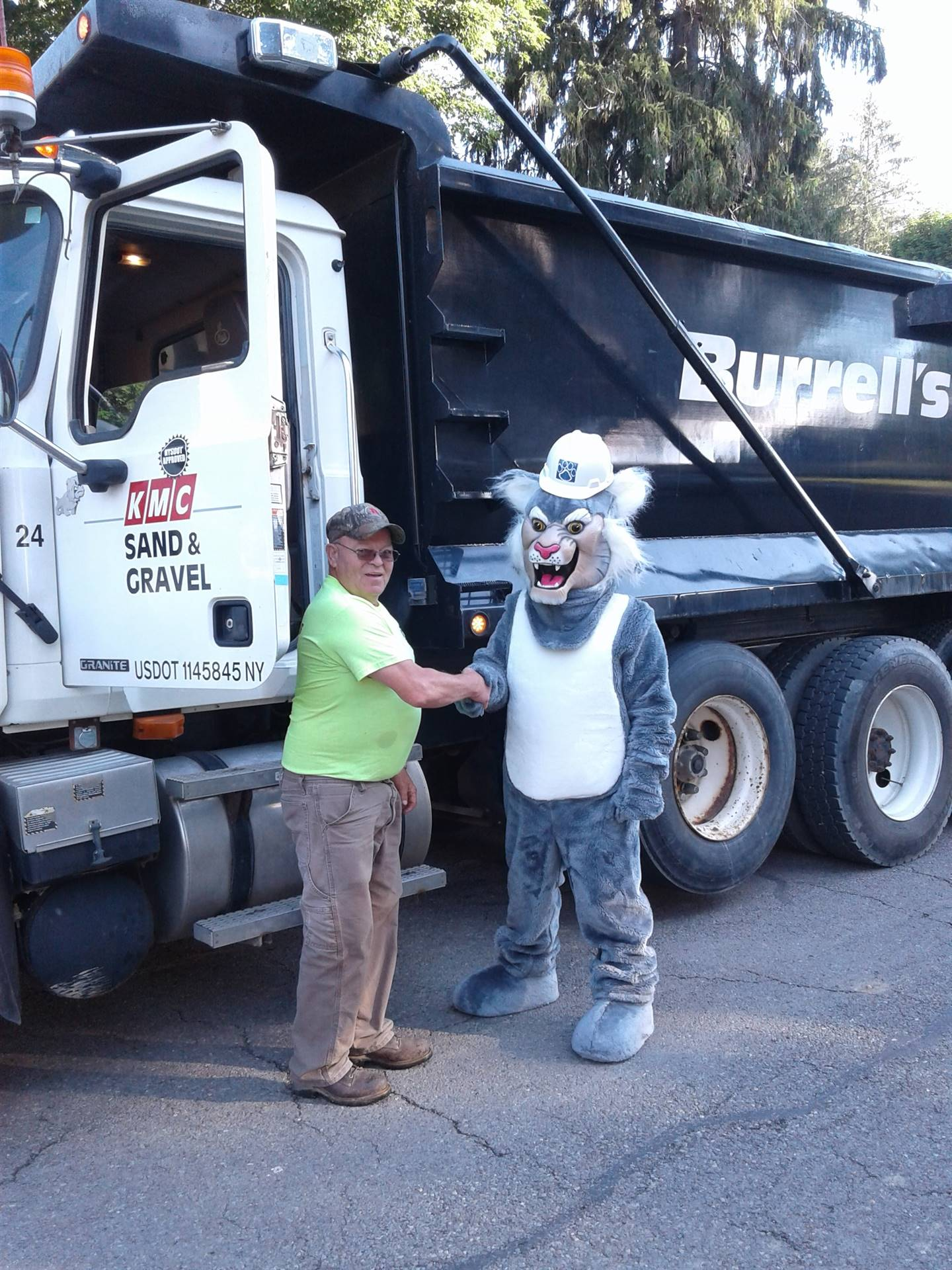 Felix shaking hands with the Burrell's dump truck driver