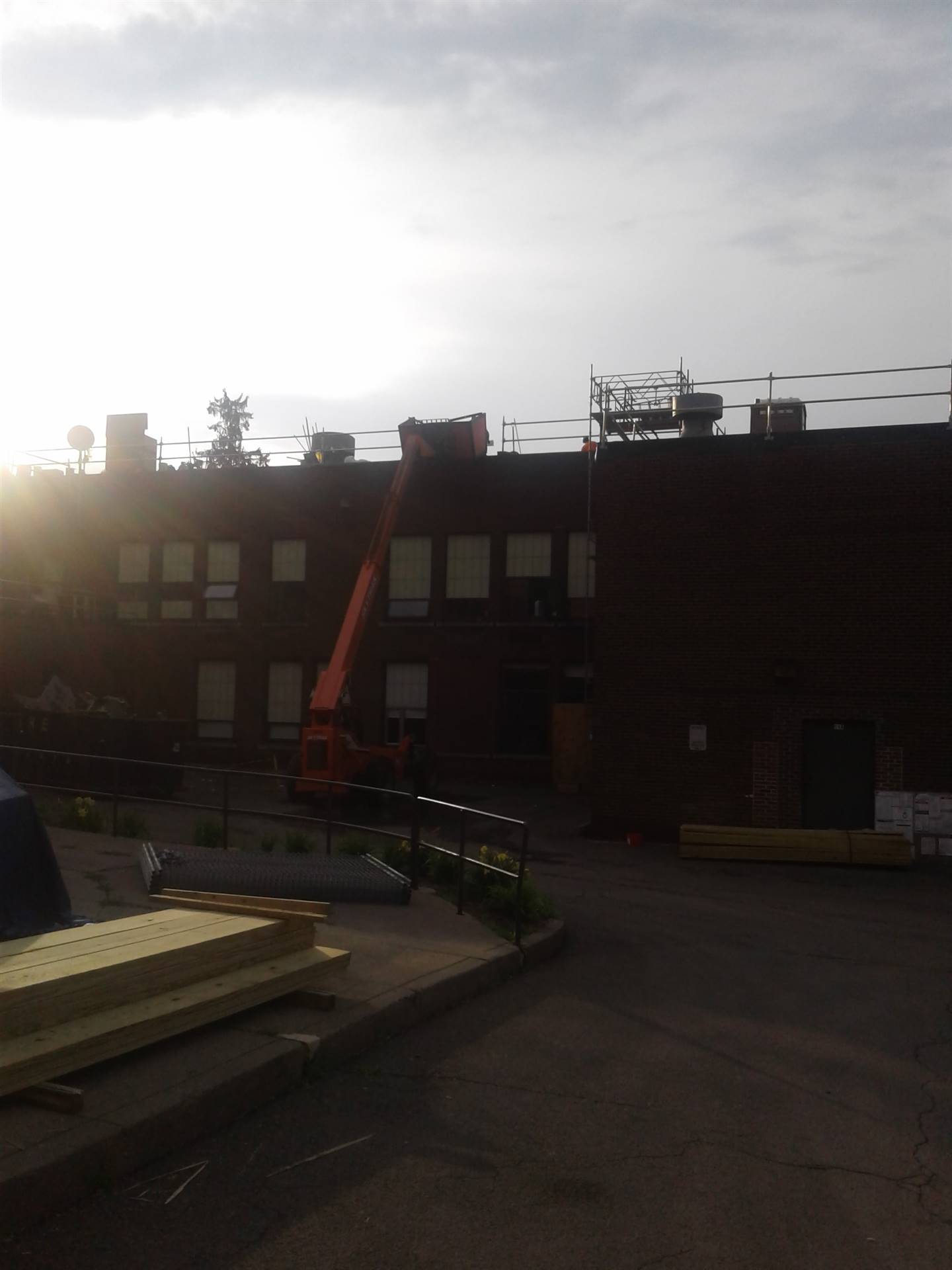 Despite the rainy days, roofing continues at the High School.