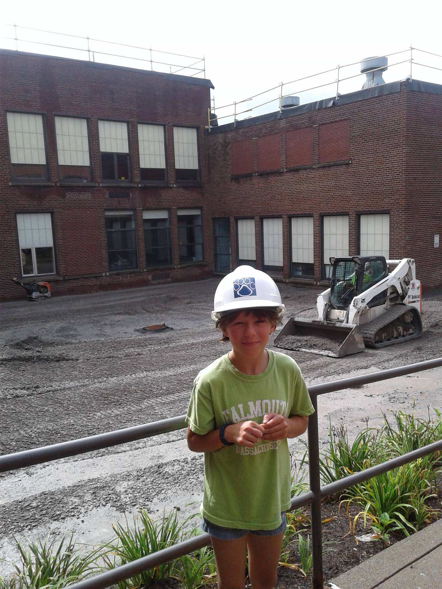 Visiting student poses in B-G Hard Hat!