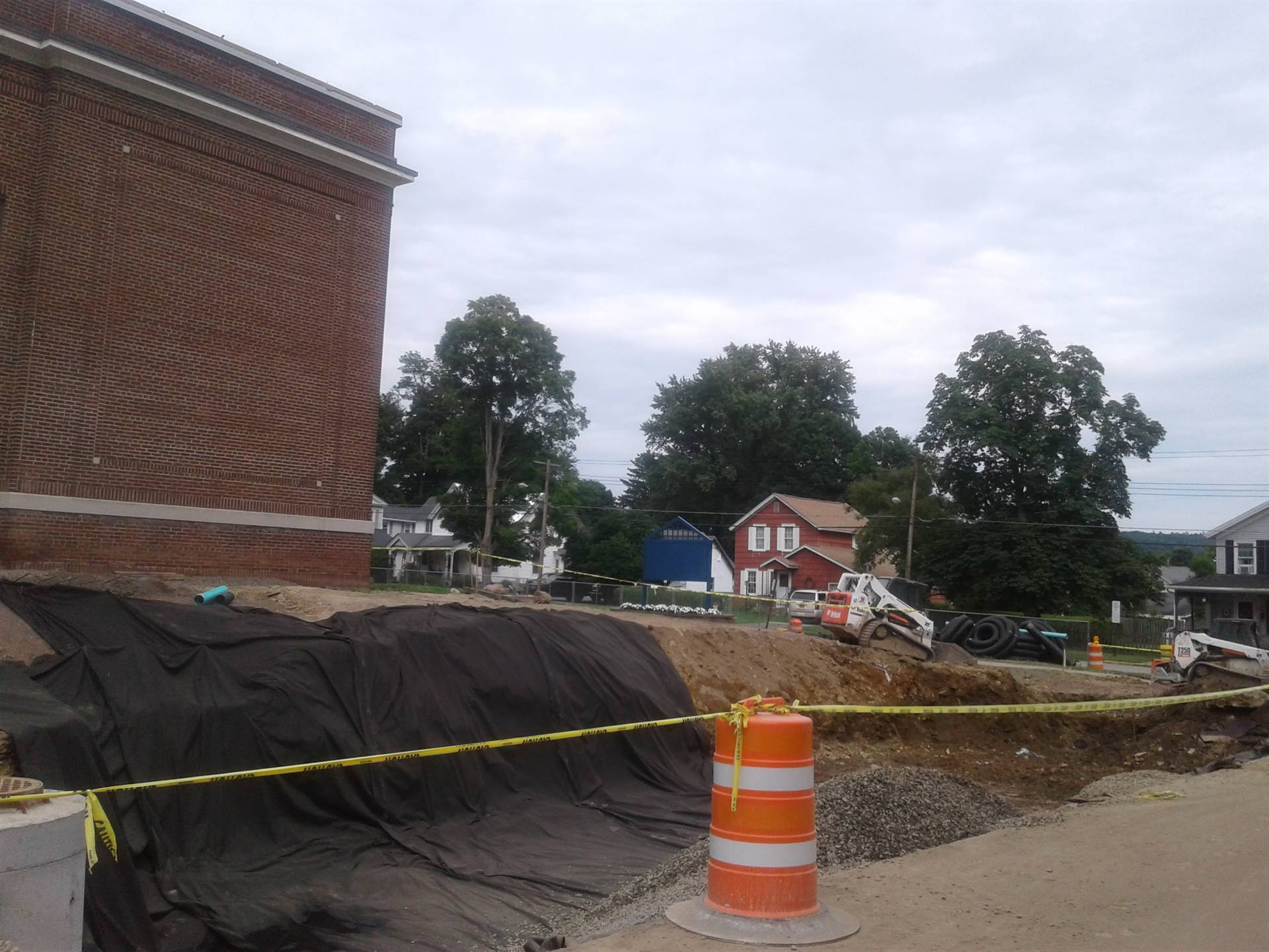 High School parking area and sidewalk on Walnut Street renovations.