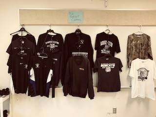 Bobcat Boutique - racks of BG shirts