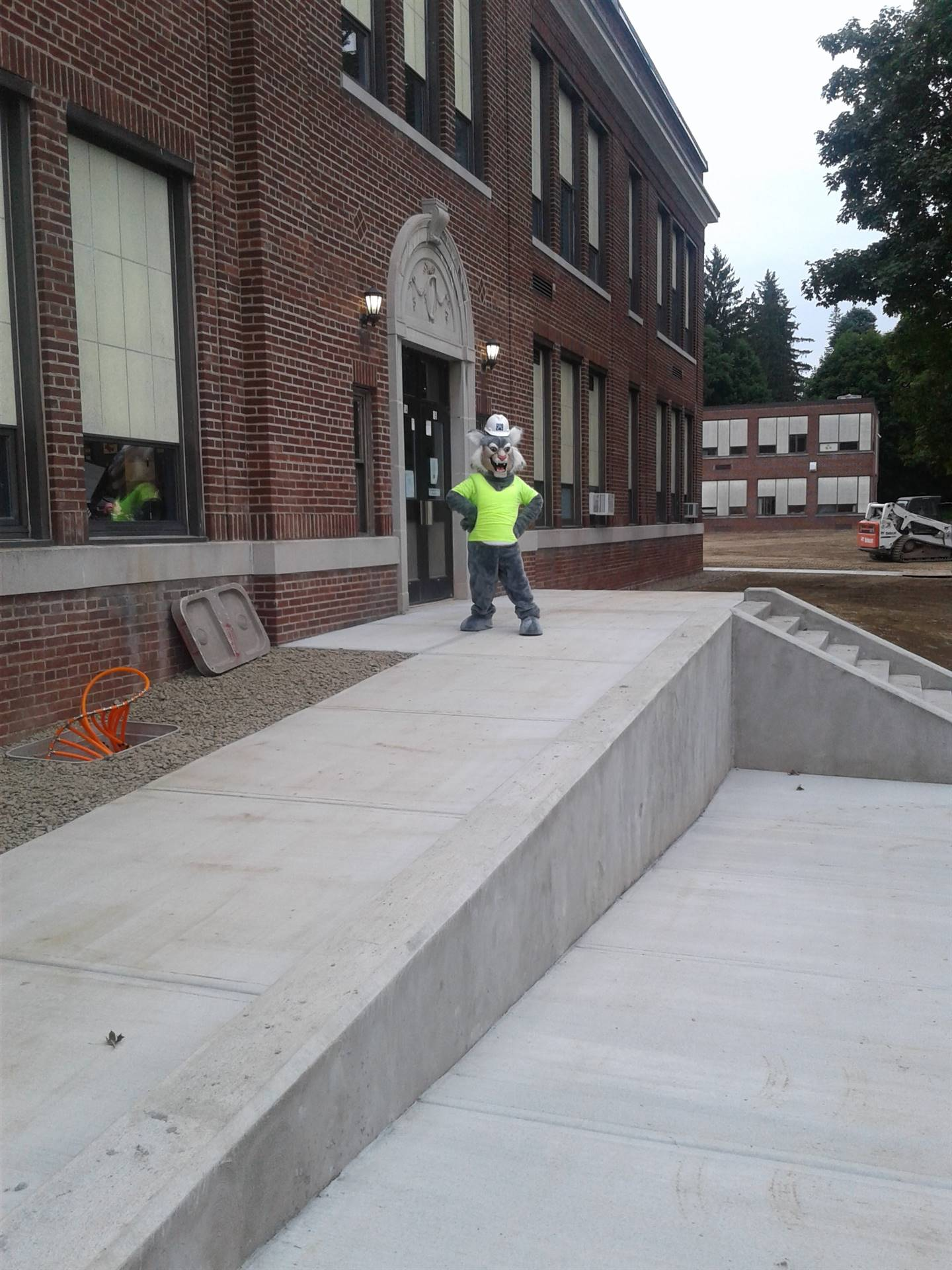 Week 9 - Capital Project - HS  - Felix checking out the new Handicap Ramp!
