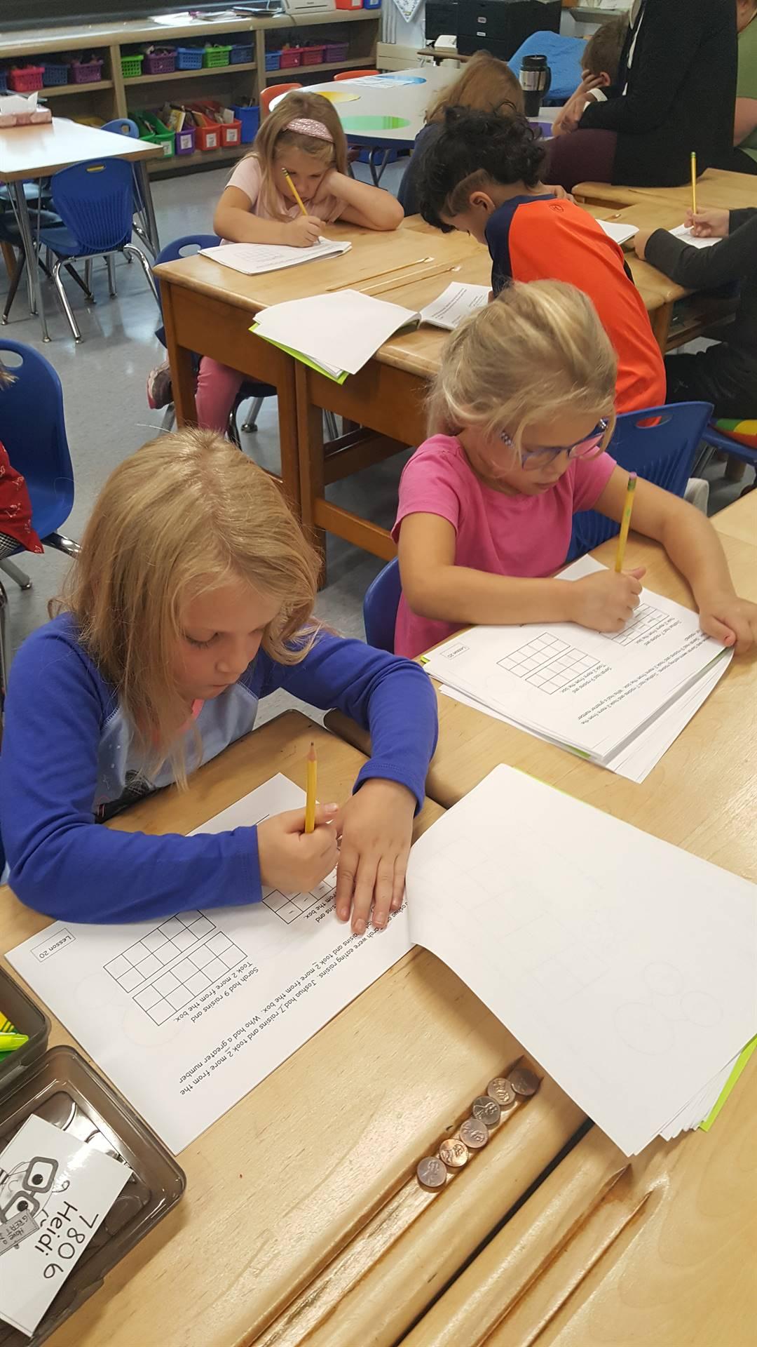 2 first graders hard at work!