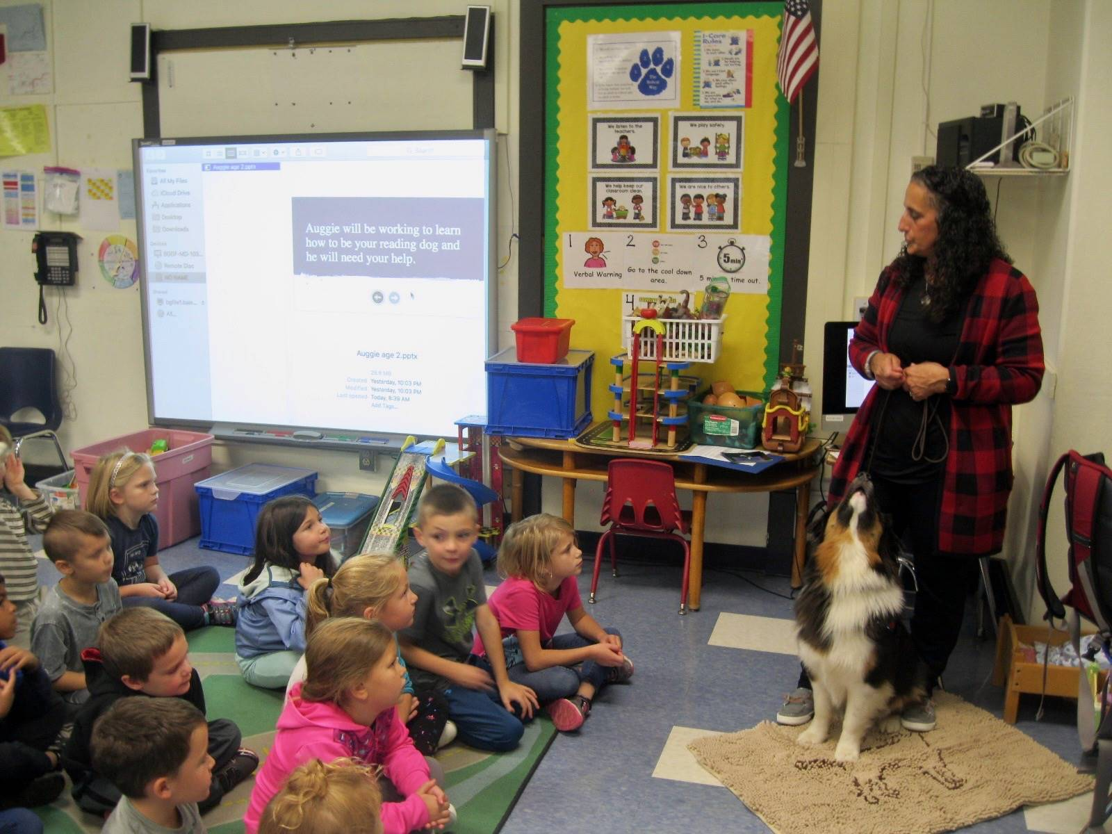 Therapy Dog and owner meets a class.