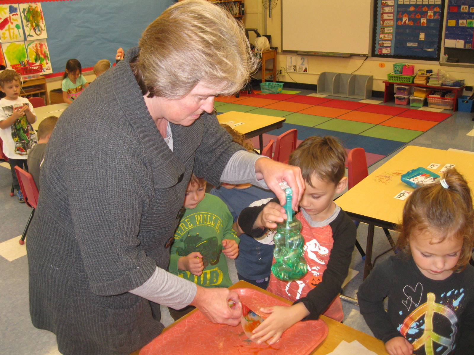 A staff member helps students.