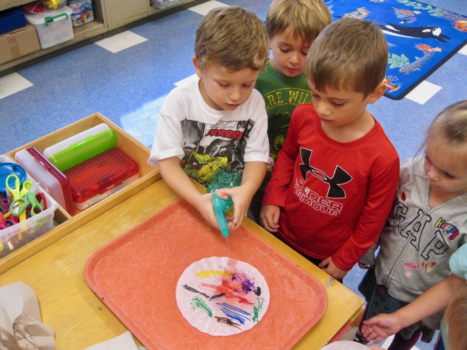 students use cooperation to spray.
