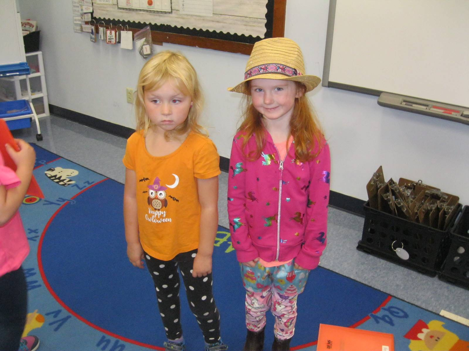 2 students with mixed up clothes.
