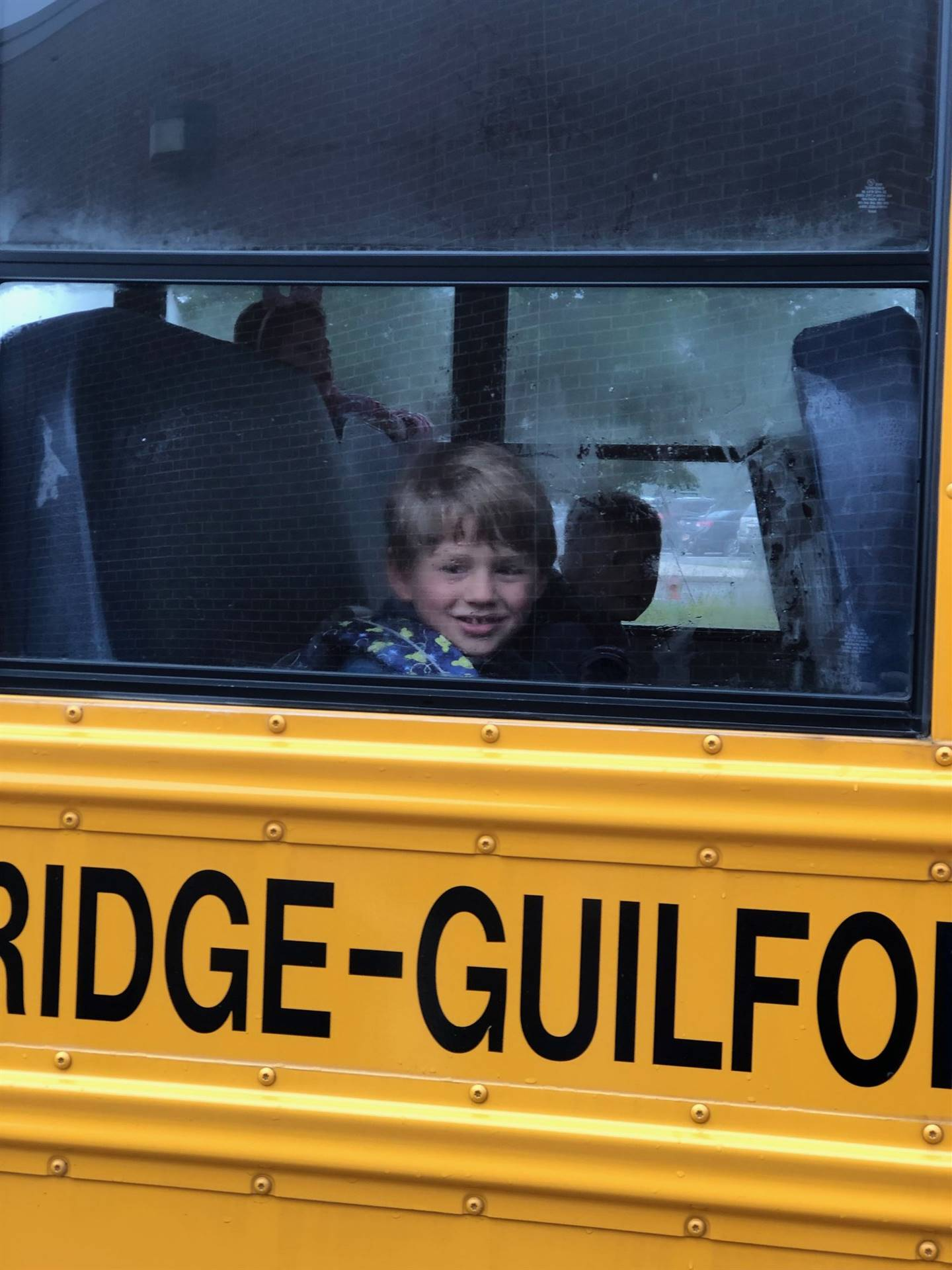 A student on the bus ready to roll!