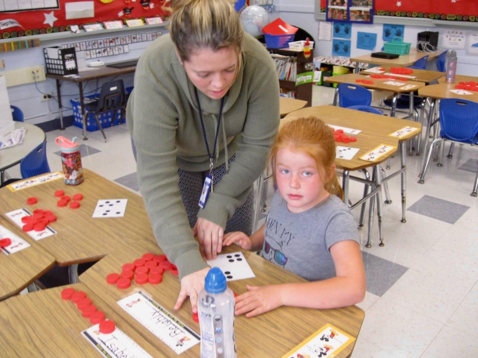 A student and teacher work on math.