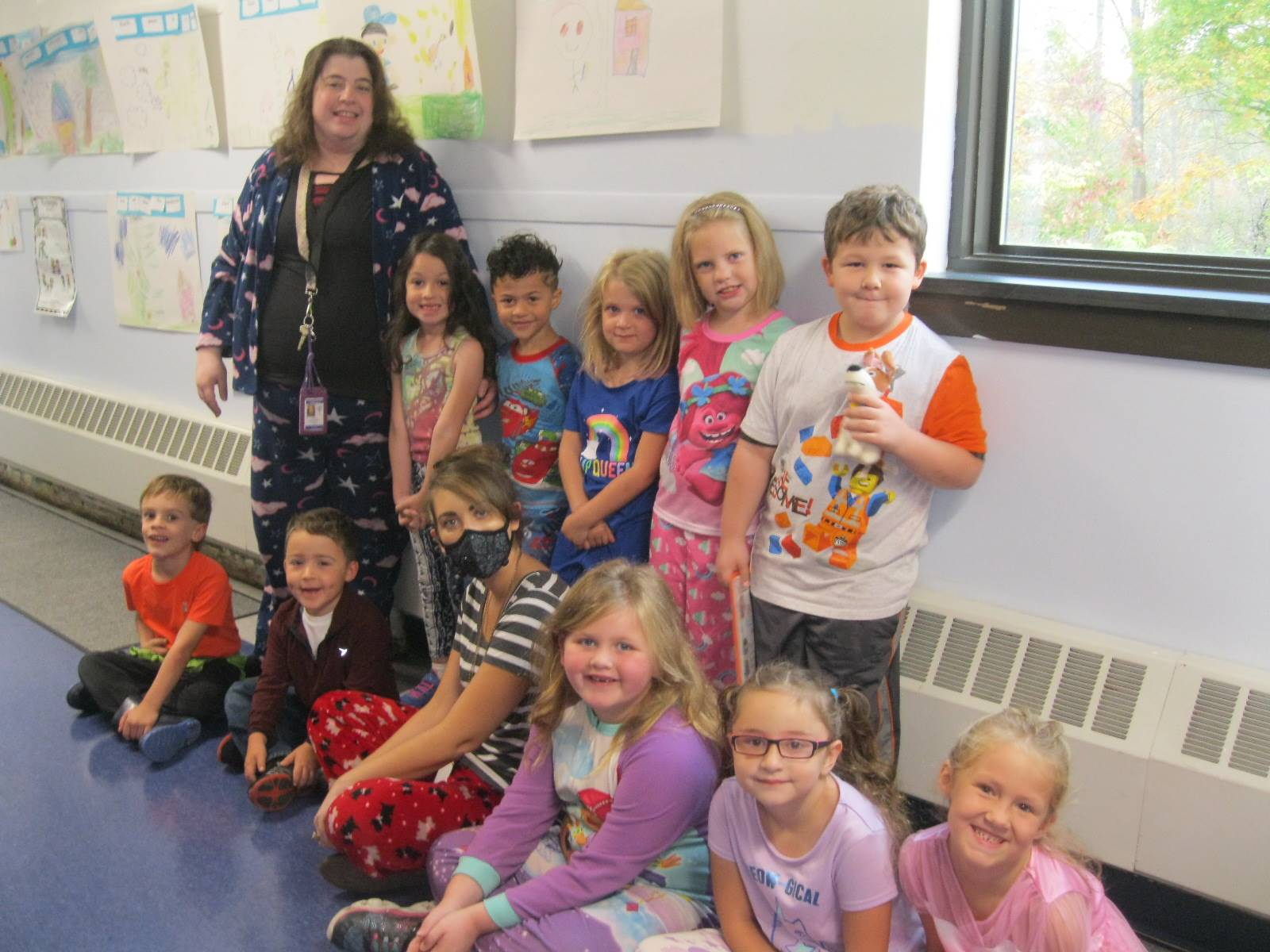 2 teachers and several students in PJS.