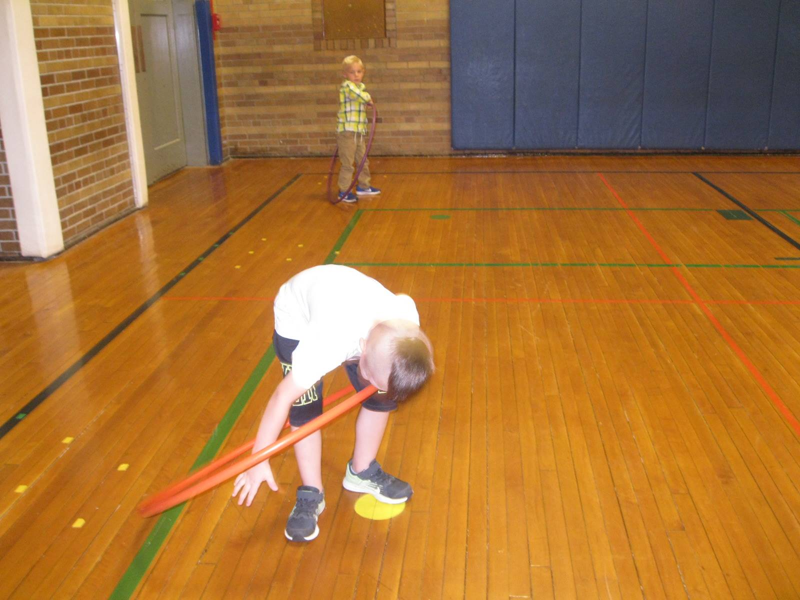 A student spins a hula hoop!
