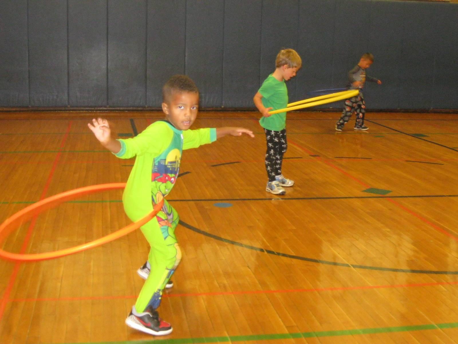 Students work on hula hoop spinning.