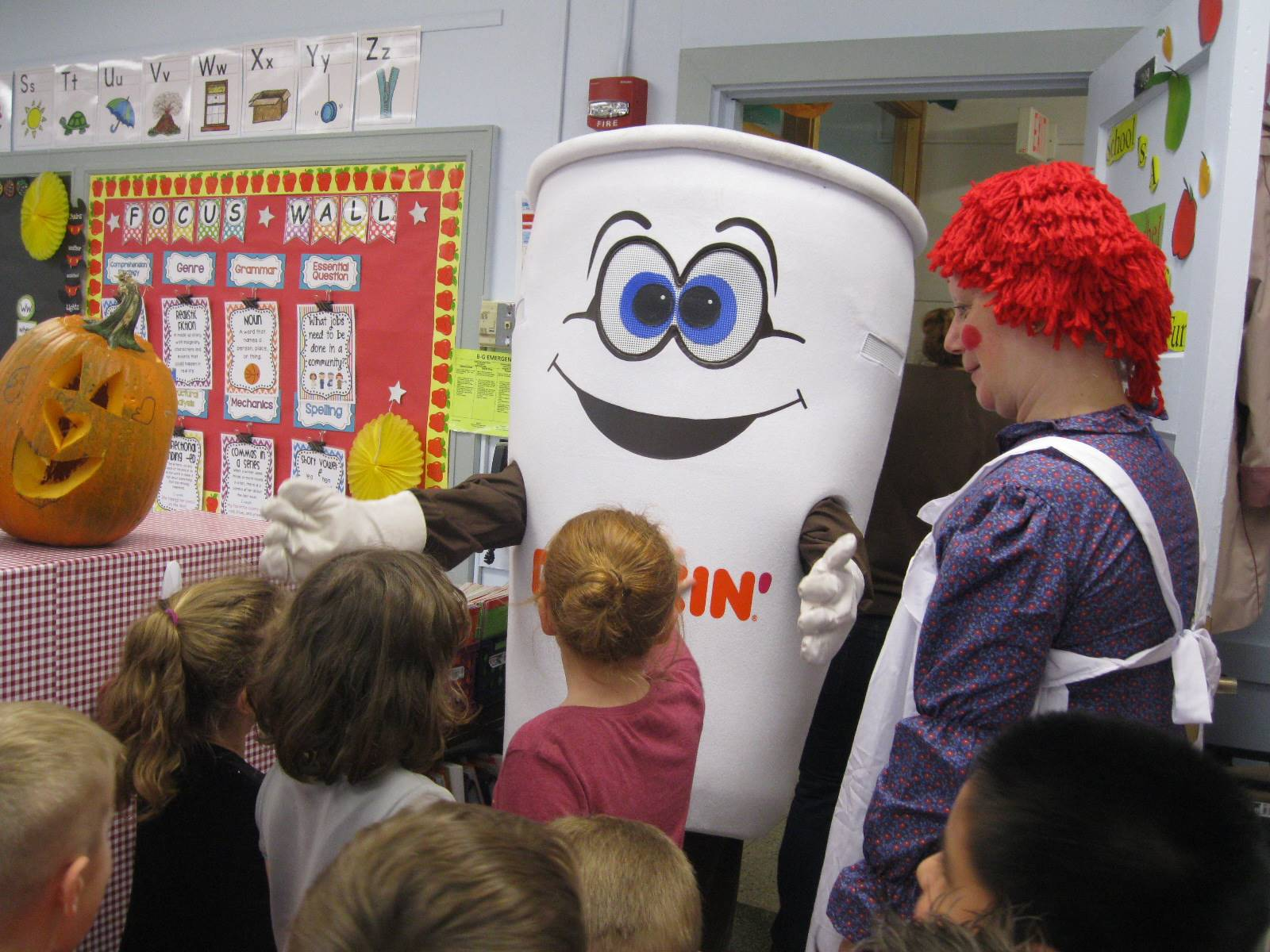 Dunkin Donut man with students.