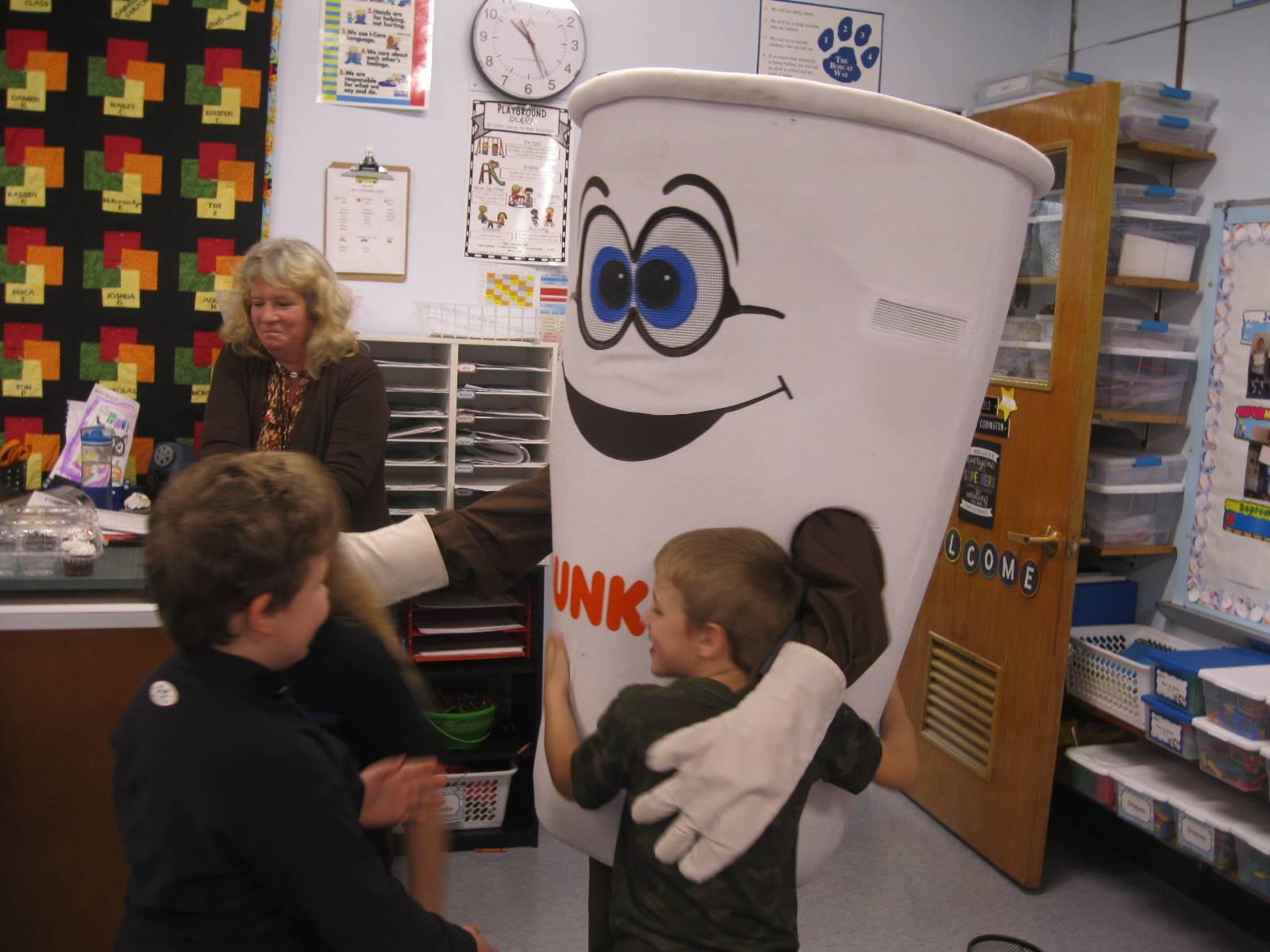 Dunkin donut man gives students hugs.