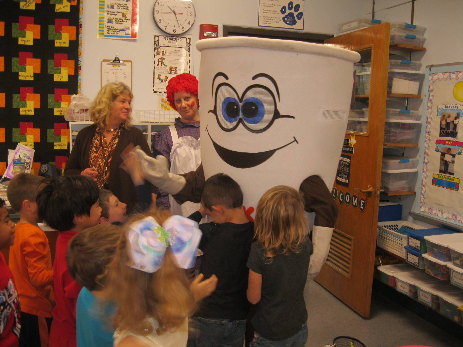 Dunkin donut man gives hugs to students.