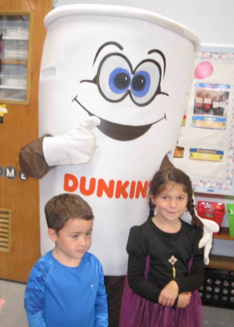 Dunkin donut man gives a thumbs up to 2 students!