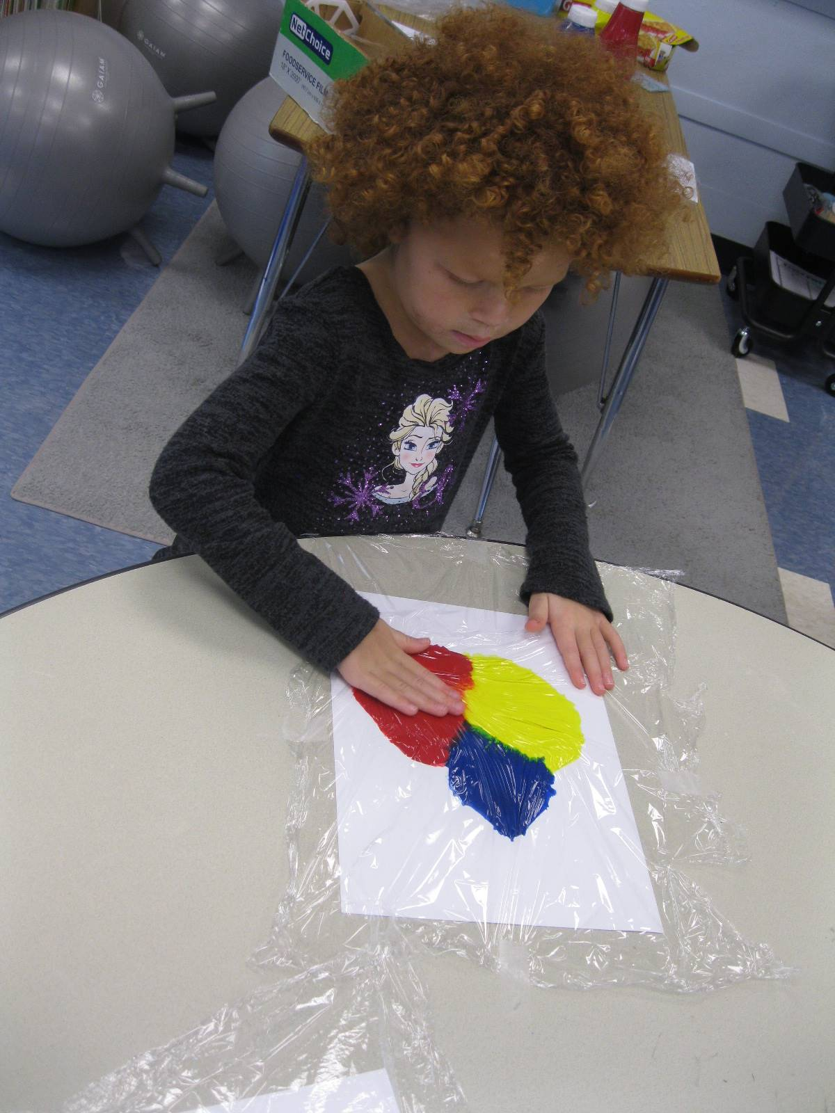 "A student ""paints"" with hands."