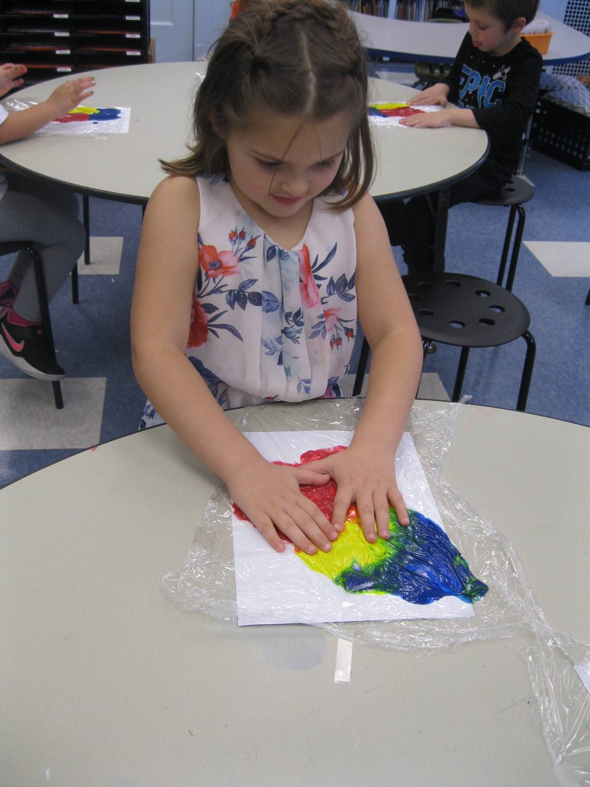 A student paints with hands