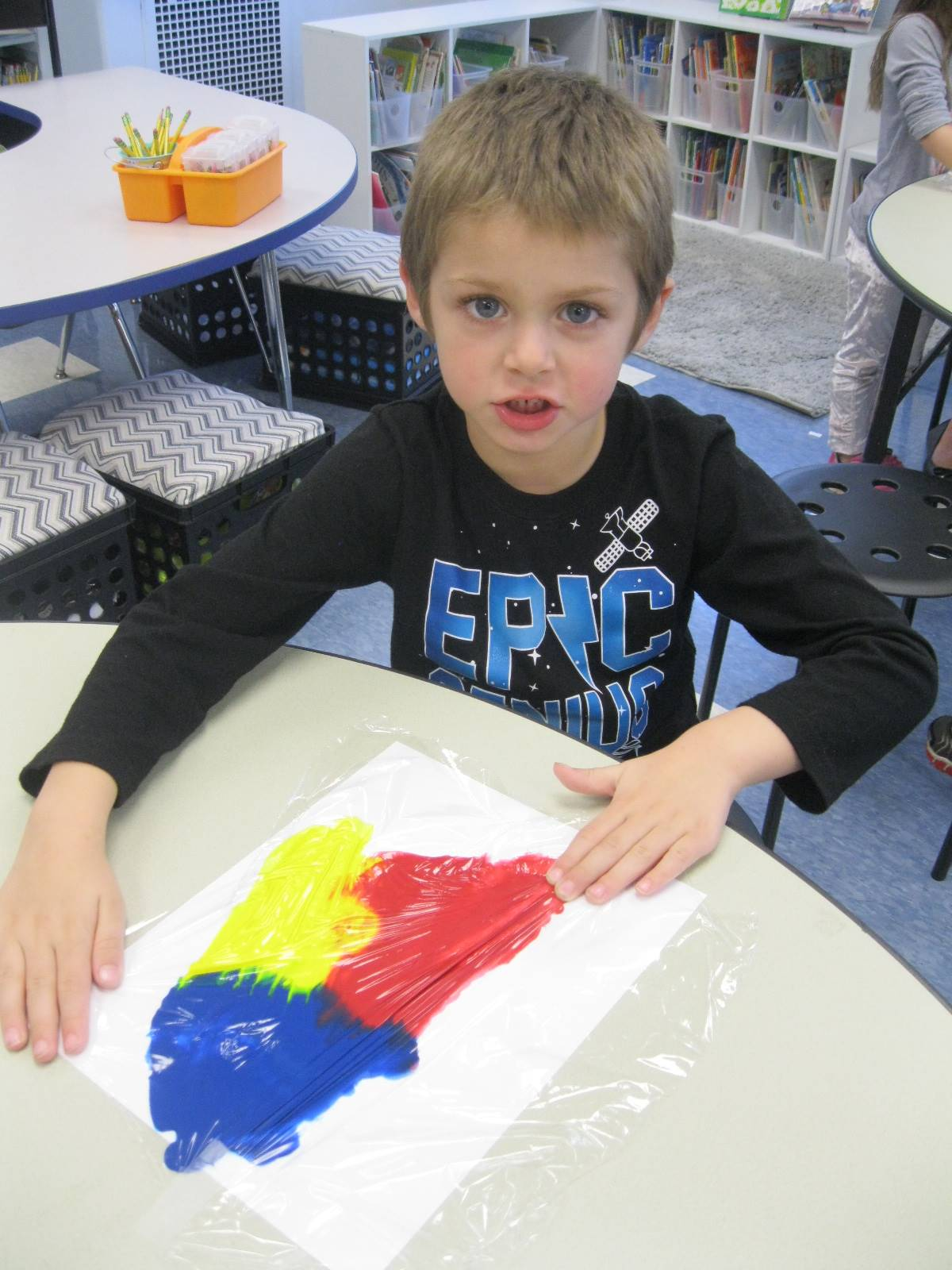 A student shows his art.