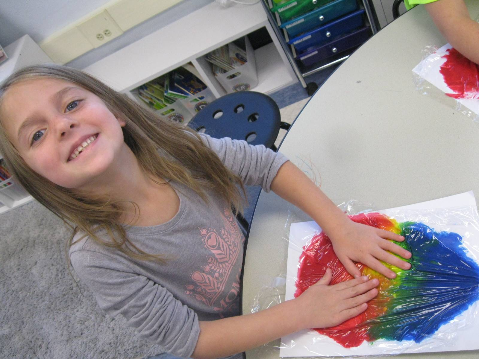 A student shows her art.
