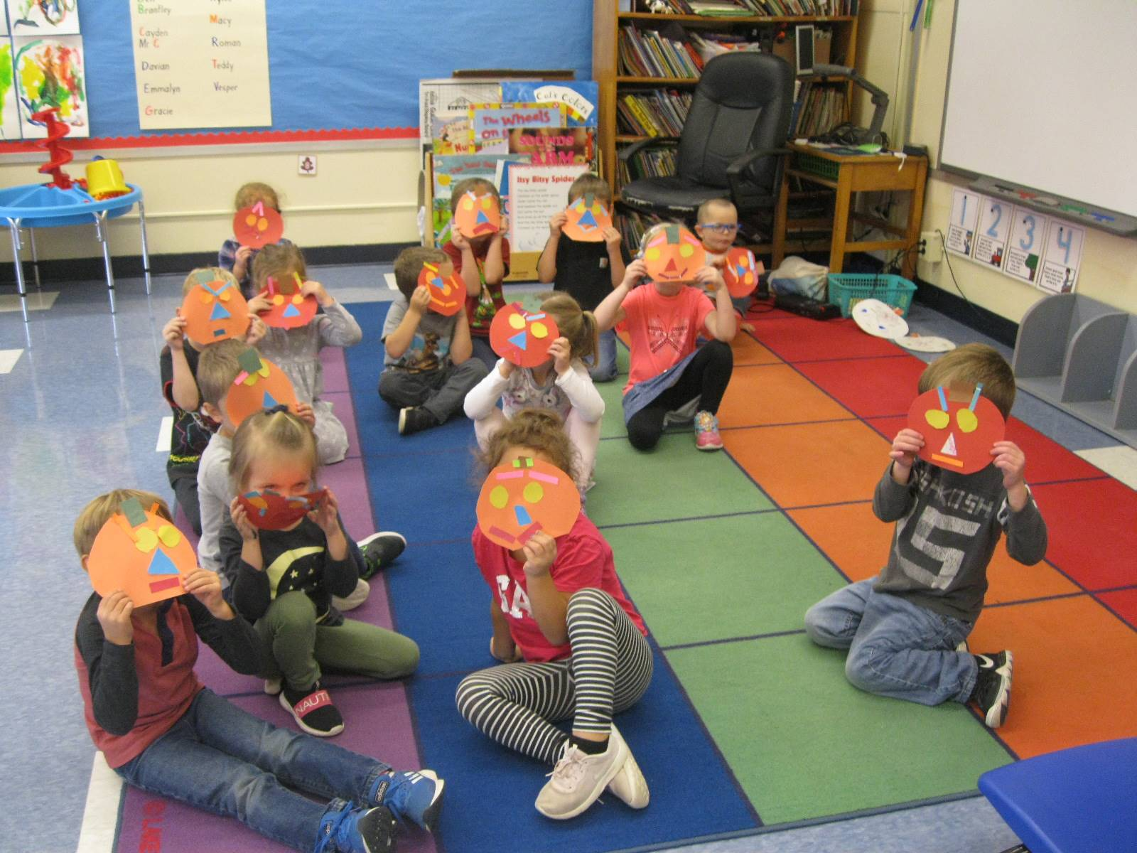 A class shows their emotions with pumpkin faces!