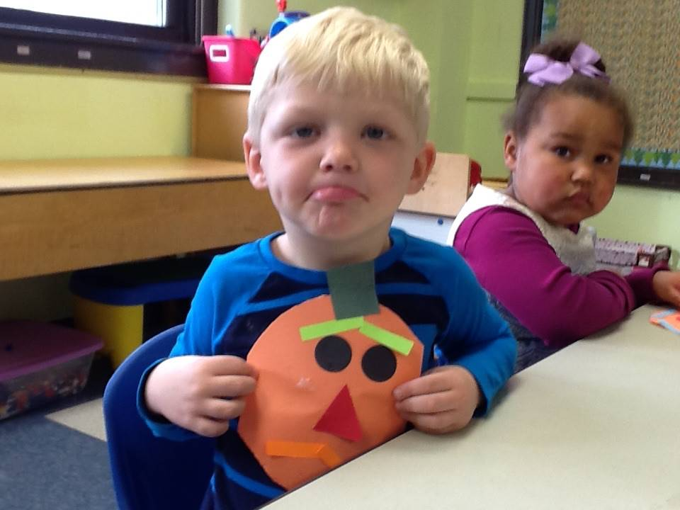 A student matches his emotion with his pumpkin emotion.