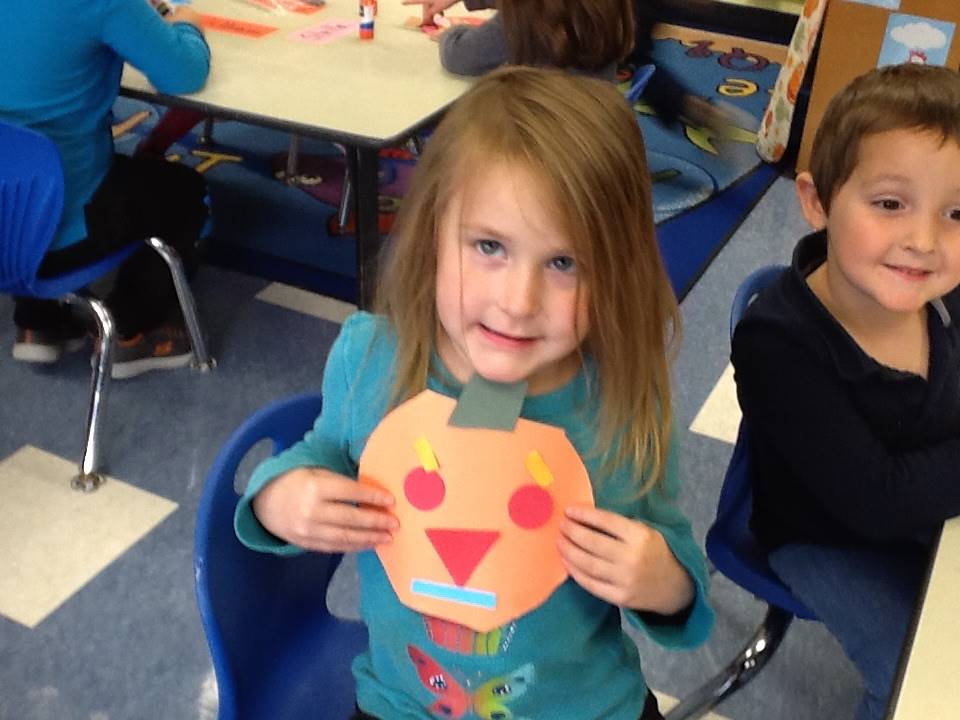 A student matches her emotion with her pumpkin emotion.