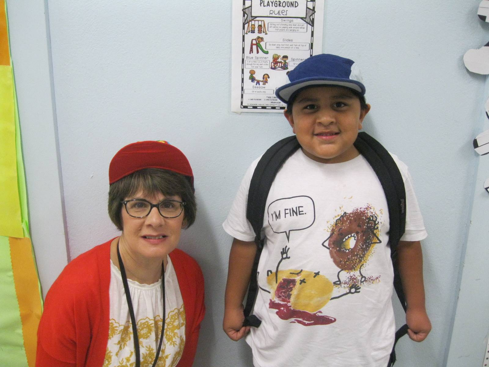 a teacher and student celebrate hat day