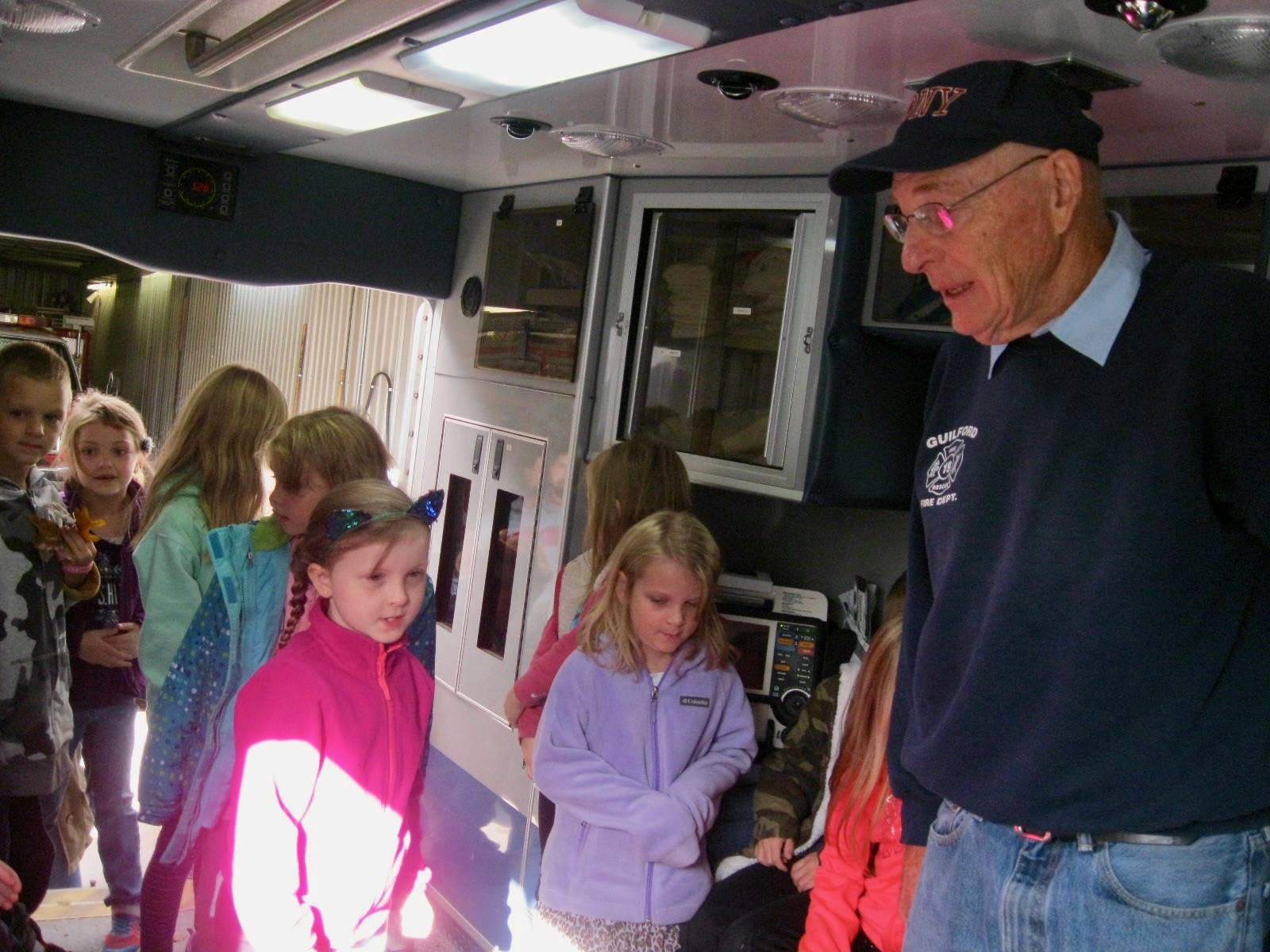 A fireman talks to a group of students