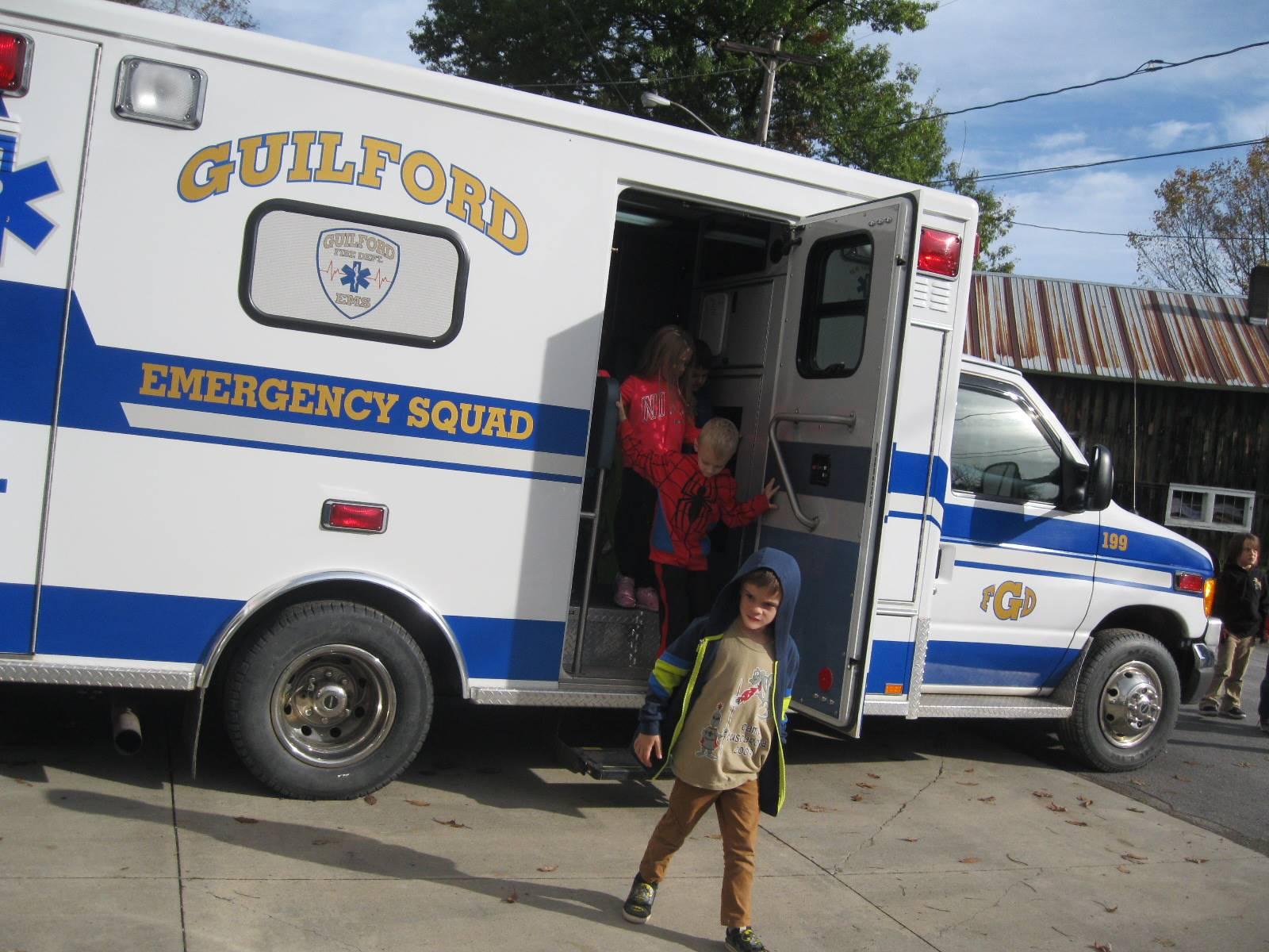 students exit ambulance