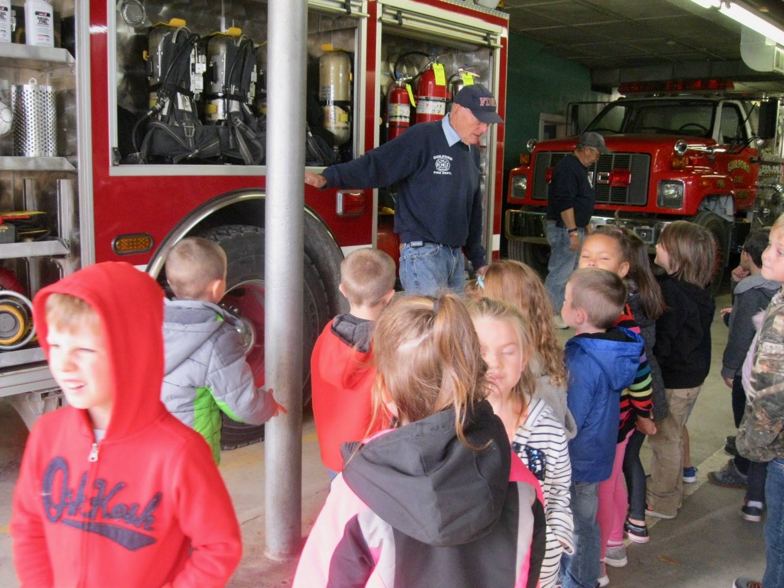 A fireman tells students what is in firetruck!