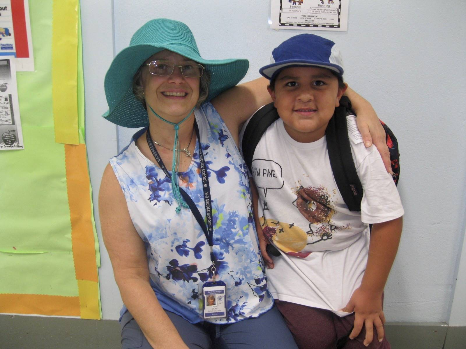 A staff member and student with hats on!