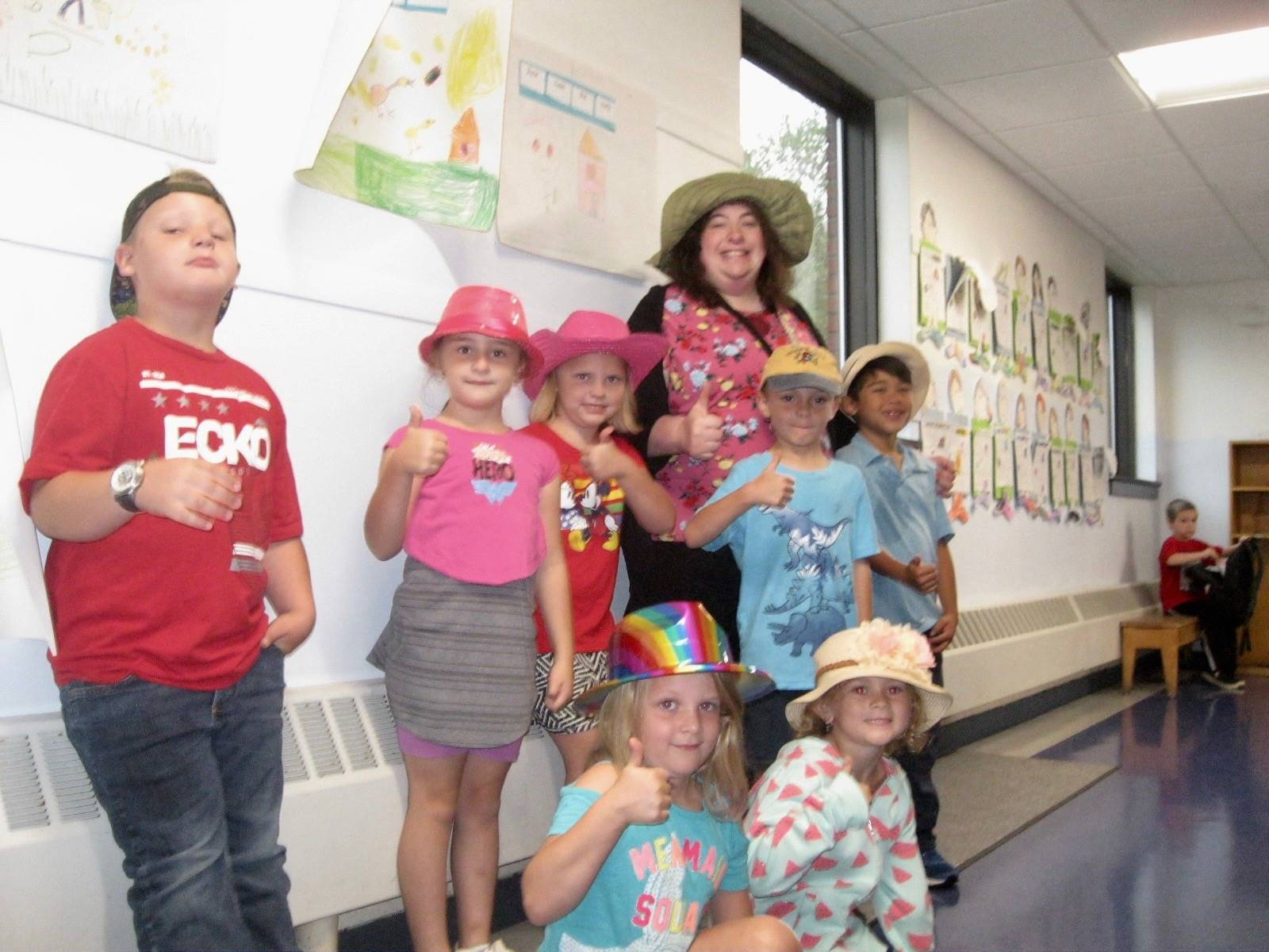 Several students and a staff member with cool hats.