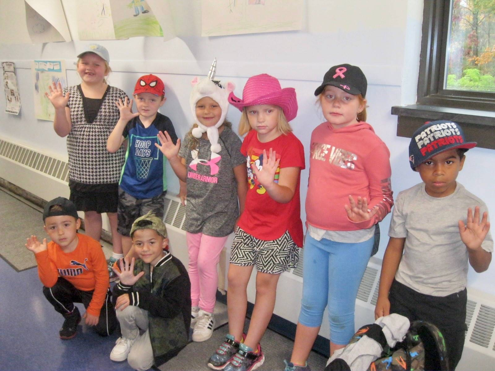 Several students show off hats