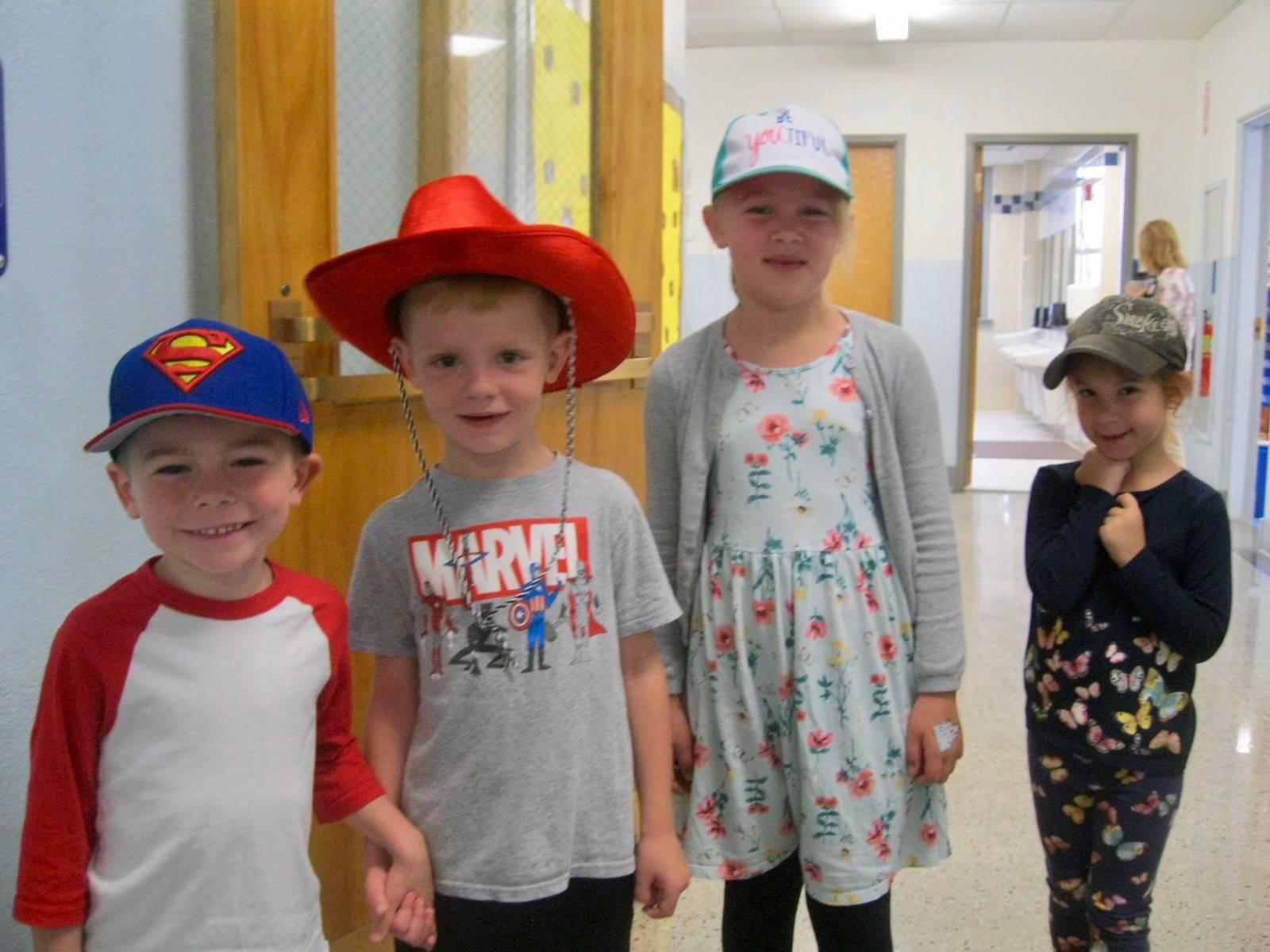 4 students and their cool hats.