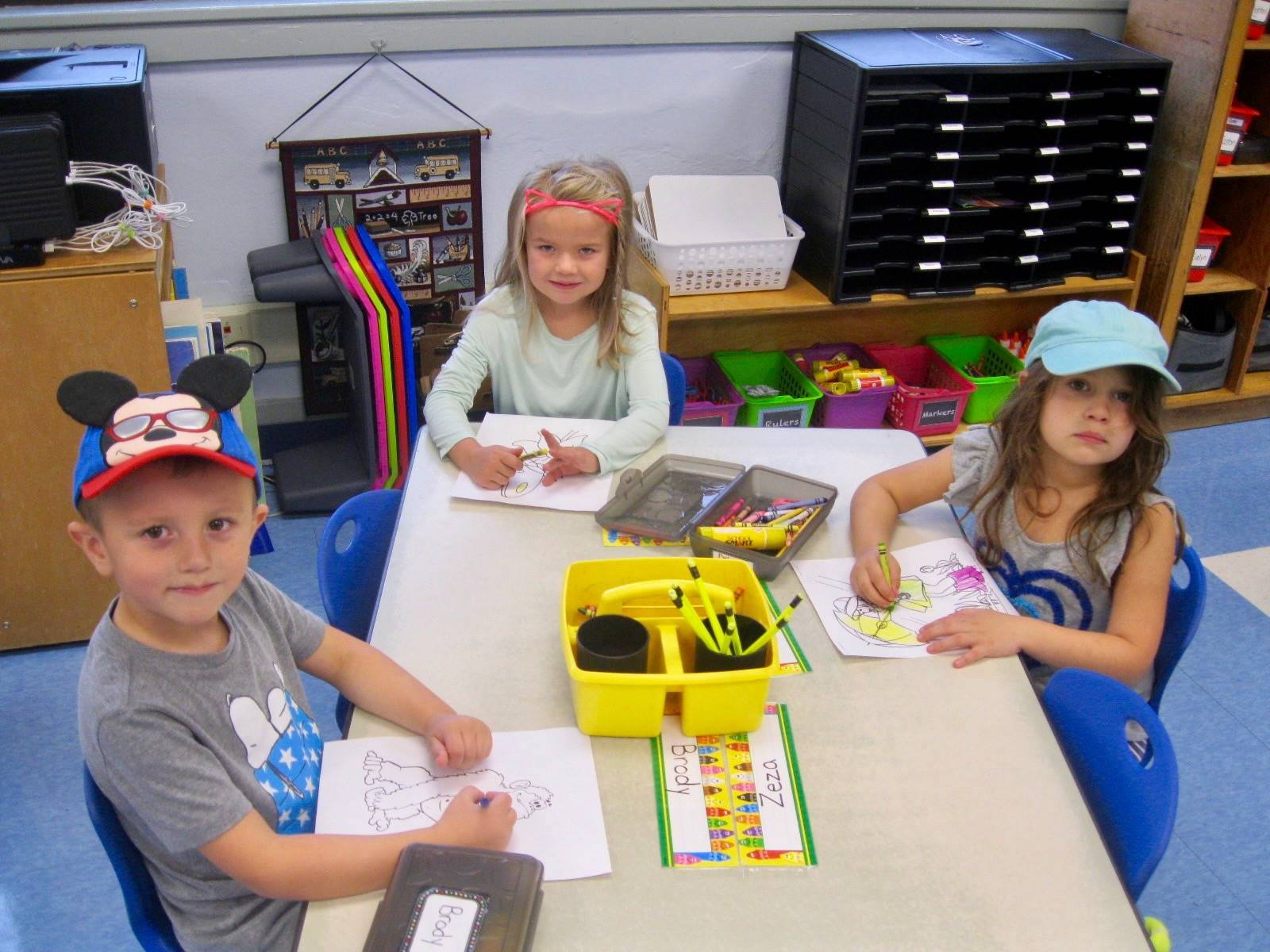 3 students work with hats on.