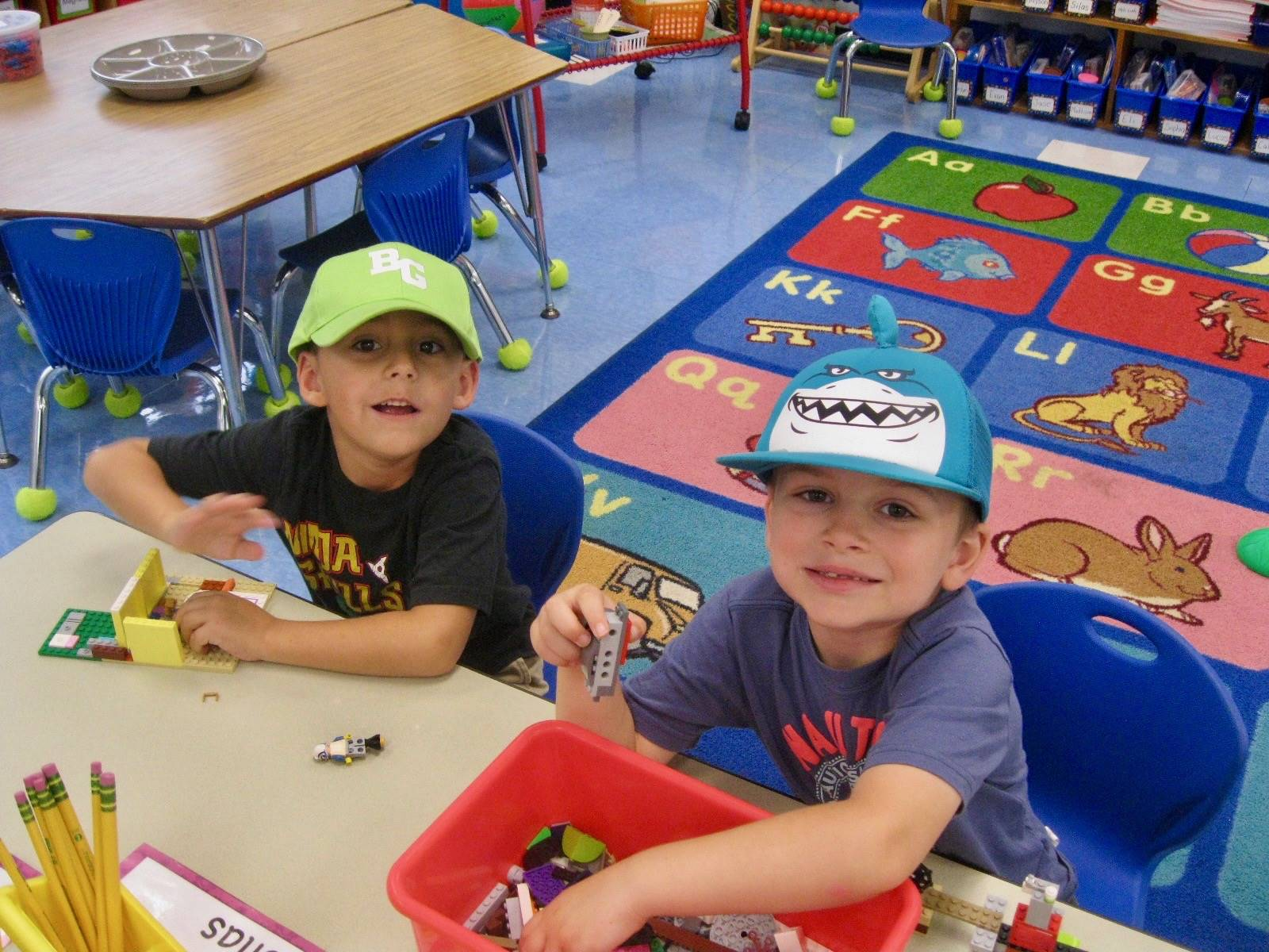 2 students work with hats on!