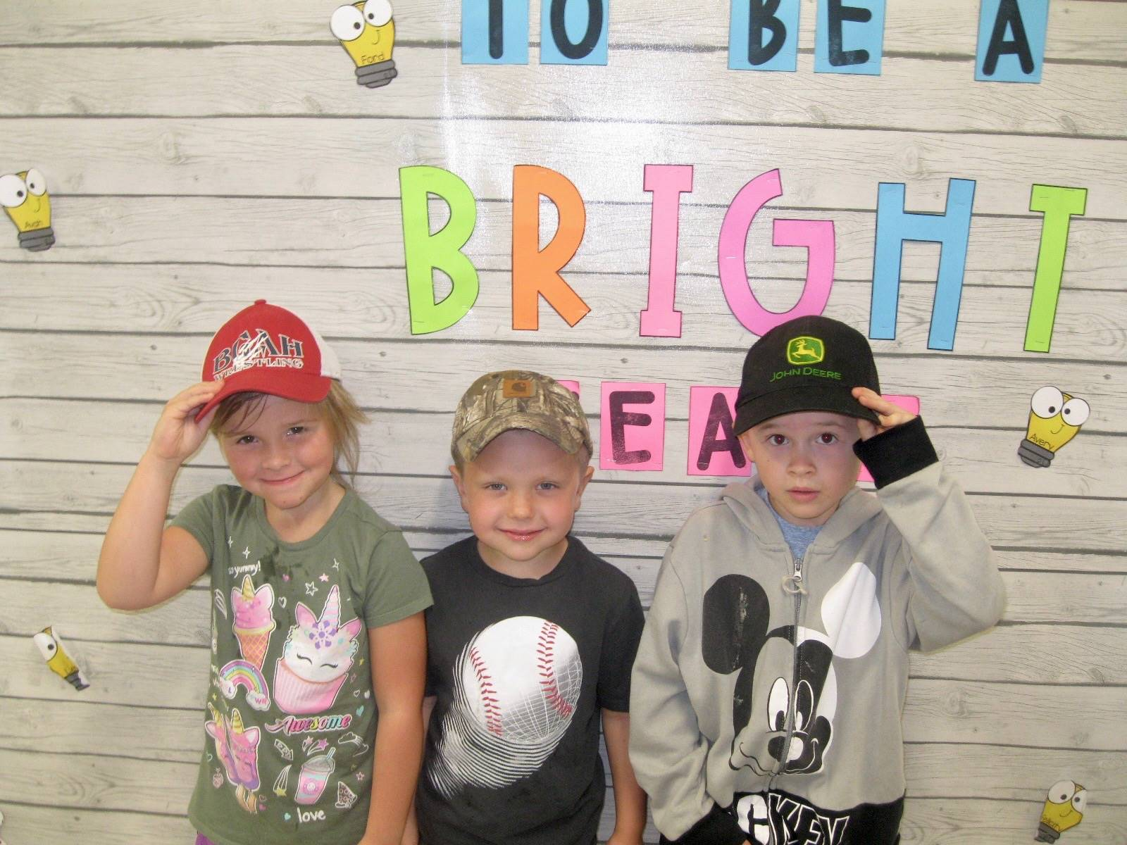 3 students saluting hat day.