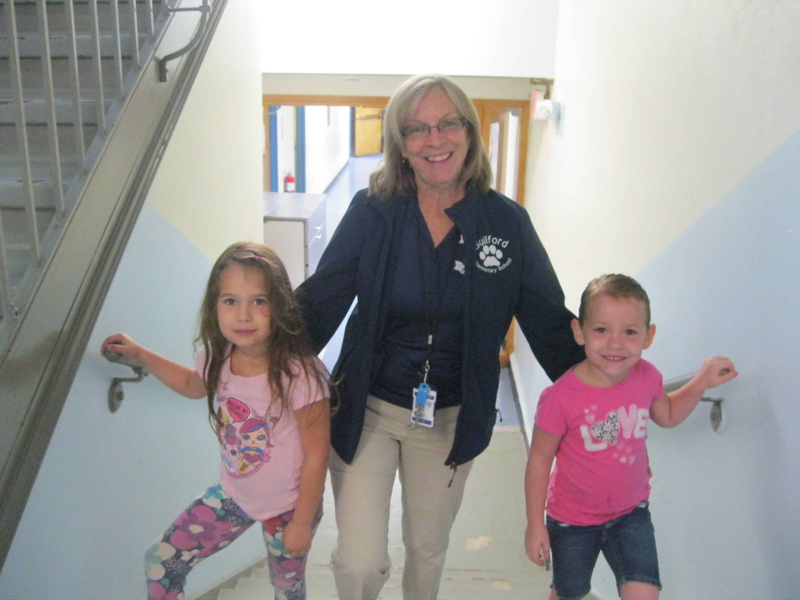 A staff member and students for blue and white day