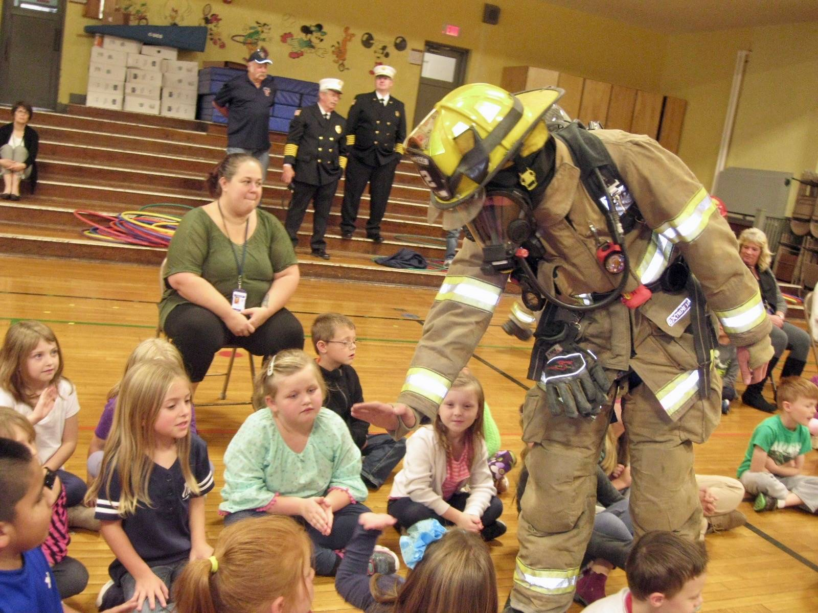 firefighter gives students high fives!